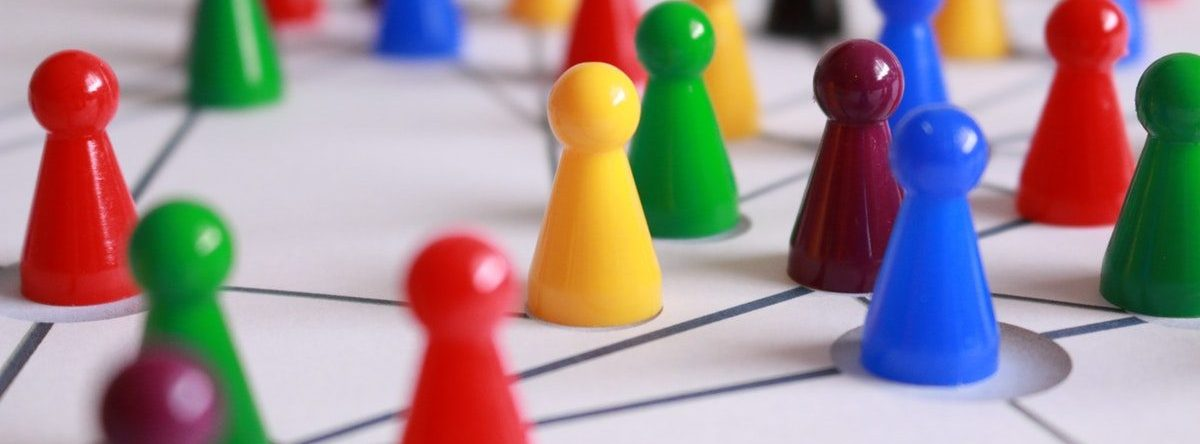 Plastic pawns representing community linkages